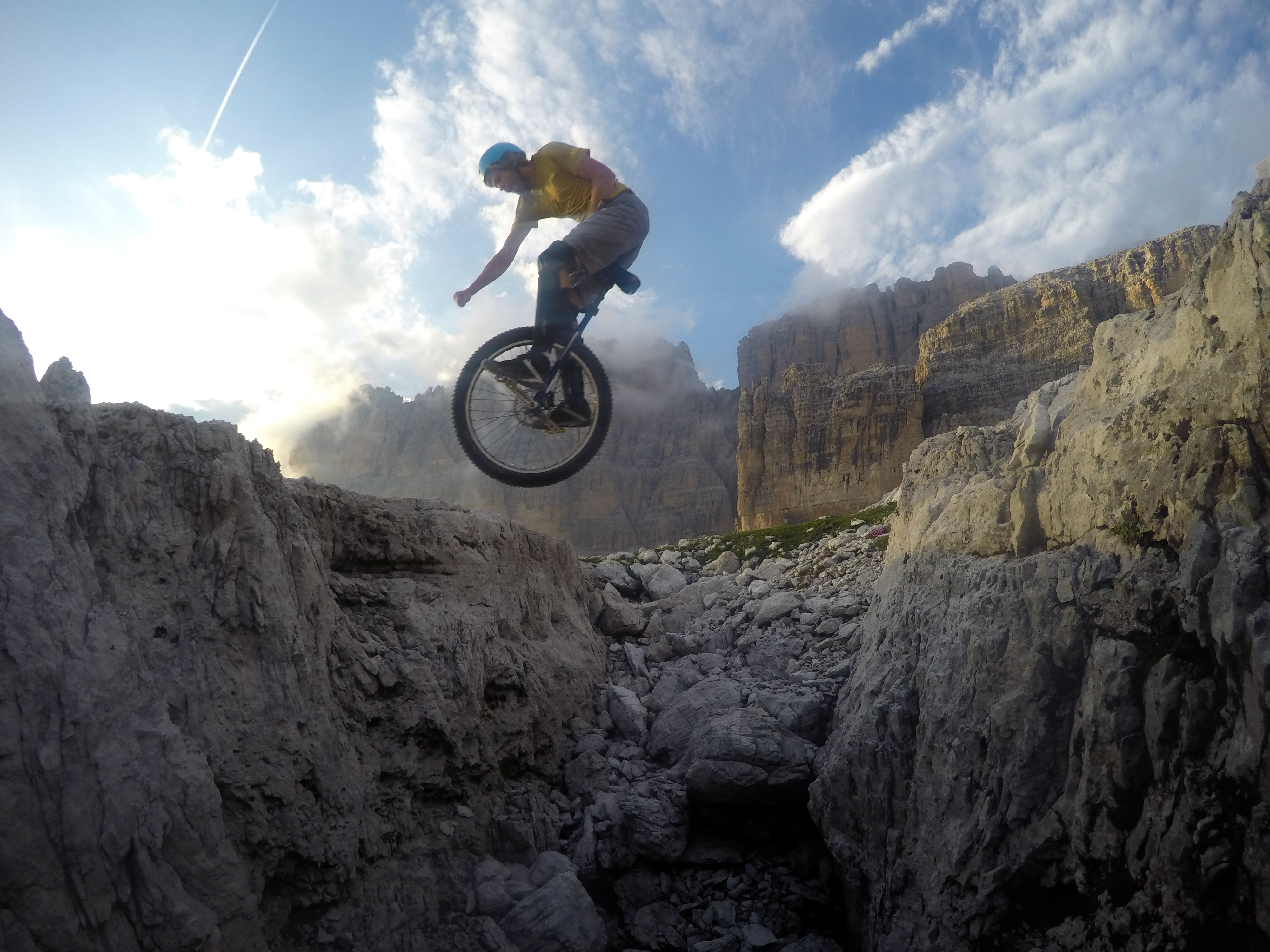 Lutz Eichholz jumping a huge gap in the Dolomites, Italy