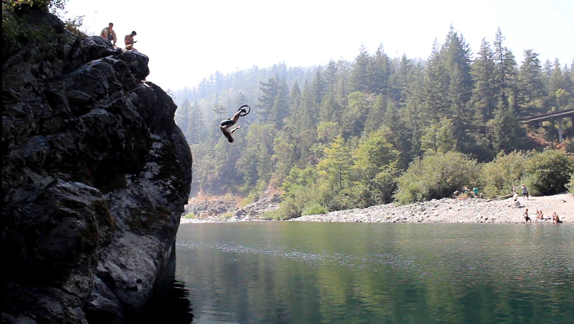 Alex doing a flip down a cliff with his unicycle